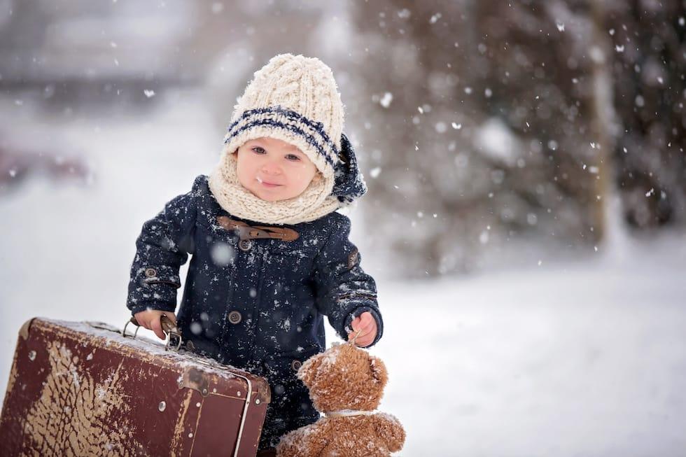 Copilas cu valiza